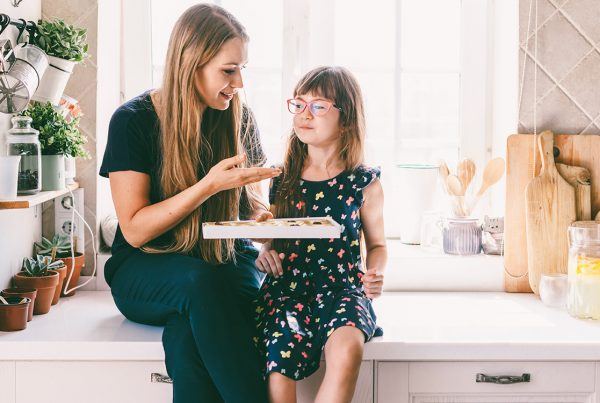 Mother and Daughter eating on kitchen counter