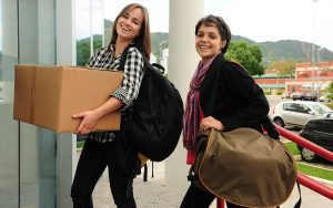 two girls moving into college dorm